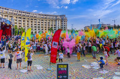 The Color Run Bucharest. Racers throw colored powder in the same time in the air at The Color Run event on April 25, 2015 in Bucharest, Romania. The Color Run is royalty free stock image