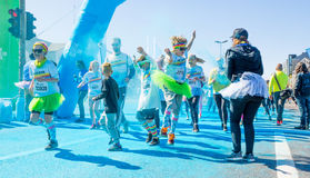Color Run participants. Reykjavik, Iceland June 6 2015 - Color Run participants having fun while going through the color blue Stock Image