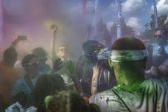 The Color Run Warsaw 2019. WARSAW, POLAND - June 1, 2019. Participants coated in paint celebrate healthiness, peace, individuality at unique colorful 5 km run royalty free stock photography