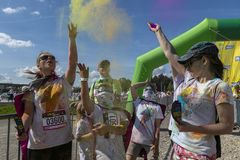 The Color Run Warsaw 2019. WARSAW, POLAND - June 1, 2019. Participants coated in paint celebrate healthiness, peace, individuality at unique colorful 5 km run royalty free stock photos