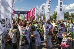The Color Run Warsaw 2019. WARSAW, POLAND - June 1, 2019. Participants coated in paint celebrate healthiness, peace, individuality at unique colorful 5 km run stock images