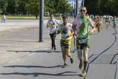 The Color Run Warsaw 2019. WARSAW, POLAND - June 1, 2019. Participants coated in paint celebrate healthiness, peace, individuality at unique colorful 5 km run royalty free stock photo