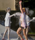 Color Runner Gets Sprayed With Glitter Mist Stock Image