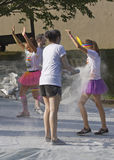 Color Runners Get Sprayed Royalty Free Stock Photos