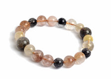 Color Rutilated Quartz lucky stone bracelet Stock Photos