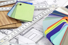 Color samples of architectural materials. Plastics, metric folding ruler and architectural drawings of the modern house royalty free stock image