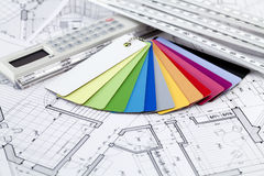 Color samples of architectural materials. Ruler calculator, color samples of architectural materials - plastics, metric folding ruler and architectural drawings royalty free stock photo