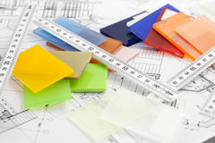 Color samples of architectural materials. Plastics, metric folding ruler and architectural drawings of the modern house stock image