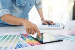 Color samples, colour chart, swatch sample, Graphic designer being selecting Color table and graphics tablet, pen at workplace wi. Th work example on wooden desk stock photos