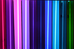 Color samples at the neon shop. A rainbow of neon color samples stock photos