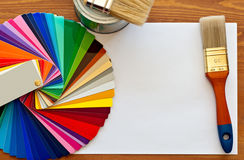 Color samples and paint brushes on the wooden table. With copy space royalty free stock image