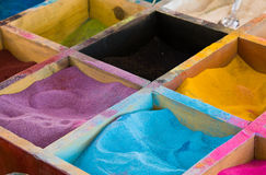 Color sands in boxes Stock Images