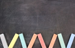 Color school chalk on a black board Stock Images