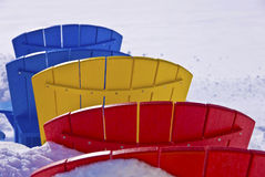 Color-seat chairs in the snow Royalty Free Stock Photography