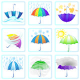 Color set of different weather symbols with colorful umbrellas Royalty Free Stock Image