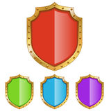 Color shield with golden frame Royalty Free Stock Photos