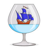 Color ship with blue sails in glass. Souvenir with sailboat for trip, tourism, travel agency, hotels, vacation card Royalty Free Stock Photo
