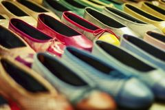 Color shoes. Many color shoes at shop in London stock image