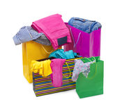 Color shopping bags with clothing Royalty Free Stock Photo