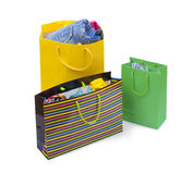 Color shopping bags with clothing Stock Images