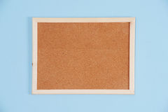 Color shot of a brown cork board in a frame. Announcement background billboard blank board brown business canvas clean clipboard communication concept Royalty Free Stock Images