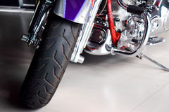 Color shot of a motorcycle forks and tire. Royalty Free Stock Image