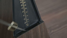 Color shot of a vintage metronome stock video footage