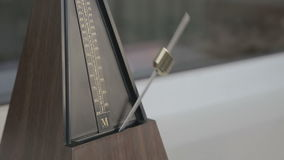 Color shot of a vintage metronome stock video