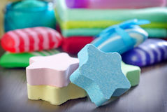 Color soaps. Spa objects, color soaps on a table Royalty Free Stock Photo