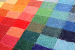 Color spectrum of carpet samples. In row Stock Photo