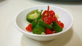Color of Spice. Green and red slided chilli, seasoning Thai dish more yummy and spicy Royalty Free Stock Photos