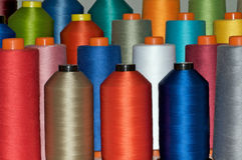 Color spools in many colors. Color spools in many, rainbow fashion colors Stock Photos