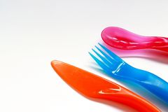 Color spoons and fork. Color spoon and fork on the white background Royalty Free Stock Photography
