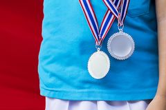 Color sports competition, children receive a silver medal from sports. Color sports competition of elementary school children, practicing ethics, discipline royalty free stock image