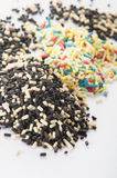 Color sprinkles pile on white background Stock Photo