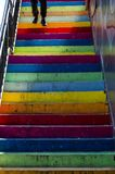 Color steps. A man stepped down a staircase of coloured cement stock photo