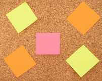 Color sticker notes. Over cork board background Stock Image