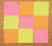 Color sticker notes. Over cork board background Stock Photos