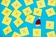 Color stickers and one selected Santa Claus hat. On blue background Stock Photo