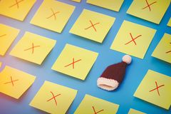 Color stickers and one selected Santa Claus hat. On blue background Stock Photography