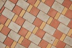 Stone paving slab. Color stone paving slab background. Brick texture royalty free stock photography