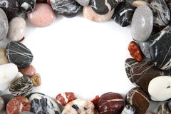 Color stones background as frame Stock Images