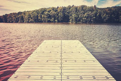 Color stylized picture of an empty pier. Royalty Free Stock Photo