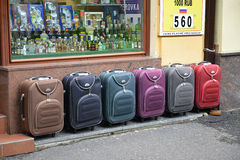 Color suitcases are on sale on the street in Karlovy Vary, the C. Zech Republic Stock Photos