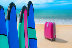 Color surf boards in a stack by ocean Stock Images