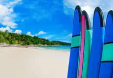 Color surf boards in a stack by ocean Royalty Free Stock Photos