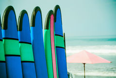 Color surf boards in a stack by ocean Royalty Free Stock Image