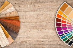 Color swatch samples and wood color guide. On wooden background royalty free stock photography