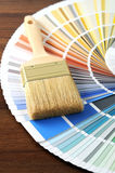 Color swatch on a table with a paintbrush Stock Photography
