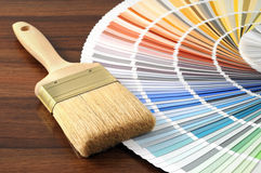 Color swatch on a table with a paintbrush Royalty Free Stock Images